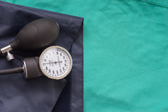 Blood pressure device located on the hospital green background. Royalty Free Stock Photography