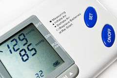 Blood pressure. Digital blood pressure apparatus, indicating pre hypertension measurement, with Diastolic between 80 to 89 Stock Photography