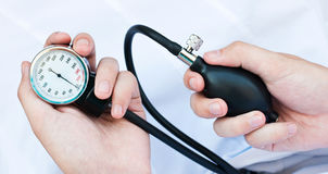 Blood pressure gage. In a doctor's hands stock photography