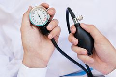 Blood Pressure Gage In a Doctor's Hands Royalty Free Stock Photos