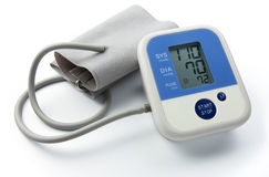 Blood pressure gauge. Digital blood pressure gauge on white background royalty free stock image