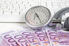 Blood pressure gauge on 500 Euro notes Stock Photos