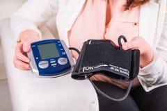 Blood pressure gauge examination Stock Image