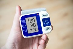 Blood pressure gauge. Hand holding blood pressure gauge Royalty Free Stock Photography