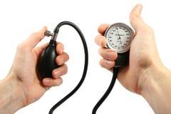 Blood pressure gauge in the hands stock photo