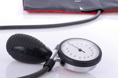 Blood pressure gauge lying on white table Stock Photography