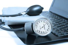Blood pressure instrument on a computer keyboard Royalty Free Stock Image