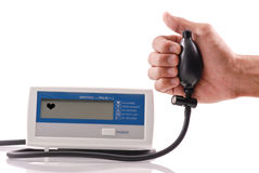 Blood Pressure Machine. With Hand Holding Pump Stock Photo