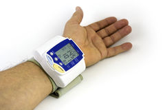 Blood pressure. Man himself measured his own blood pressure on a wrist royalty free stock image