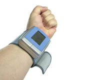 Blood Pressure Measurement. View of forearm with blood pressure cuff attached, white isolation Royalty Free Stock Images