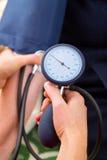 Blood pressure measurement Royalty Free Stock Images