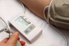 Blood pressure measurement with a tonometer. Cuff for air, pear for inflation, connecting ducting soft rubber tubes stock photos
