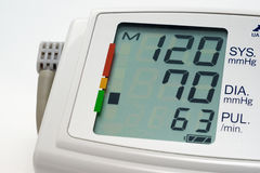 Blood pressure measuring. Indicates normal pressure on a white background Royalty Free Stock Photos