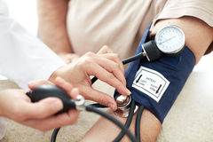 Blood pressure measuring. Doctor and patient.  Health care Stock Image