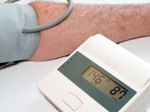 Blood pressure measuring with automatic tonometer. Medical health background with high blood pressure measuring with automatic tonometer Stock Photos