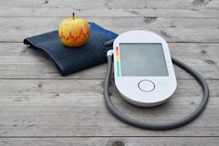 Blood pressure measuring device and apple royalty free stock photography