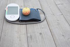 Blood pressure measuring device and apple royalty free stock image