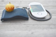 Blood pressure measuring device and apple stock photos