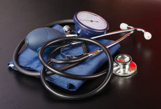Blood pressure measuring device. On isolated black background Royalty Free Stock Photography