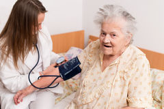 Blood pressure measuring. Health care Royalty Free Stock Photos
