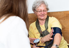 Blood pressure measuring. Health care Royalty Free Stock Images