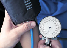 Blood pressure measuring. In hospital Stock Photography