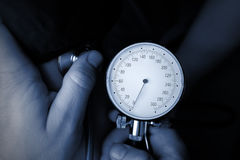 Blood pressure measuring by medical doctor Stock Images