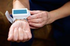 Blood pressure measuring. Royalty Free Stock Image