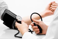 Blood pressure measuring studio shot. On white background Stock Image