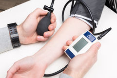 Blood pressure measuring. With a tonometer Stock Image
