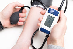 Blood pressure measuring. With a tonometer Stock Photos