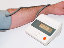 Blood pressure medical test with tonometer Stock Images