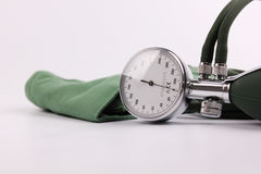 Blood pressure meter. Closeup of blood pressure meter or sphygmometer with cuff, white background Stock Photo