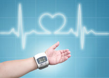 Blood pressure meter on man wrist Stock Photography