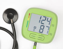 Blood pressure meter and stethoscope isolated on a white backgro Royalty Free Stock Images