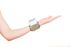Blood pressure monito on hand Royalty Free Stock Image