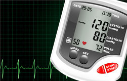 Blood pressure monitor. A digital blood pressure monitor against a computer screen showing heartbeat. Space for text Stock Images