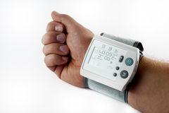 Blood pressure monitor. An am with a blood pressure monitor Stock Images