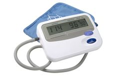 Blood pressure monitor. A blood pressure monitor isolated on white with path stock image