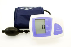 Blood pressure monitor. Modern digital blood pressure measurement equipment isolated on whie Royalty Free Stock Image