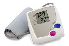 Blood pressure monitor. Automatic digital blood pressure monitor over white background Royalty Free Stock Photos