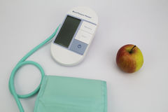 Blood Pressure Monitor with Apple Stock Photography