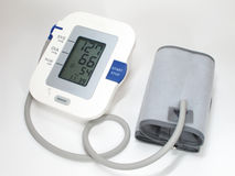 Blood pressure monitor and cuff Royalty Free Stock Photo