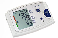 Blood pressure monitor cutout. Automatic digital blood pressure monitor. Isolated on white with clipping path Royalty Free Stock Photography