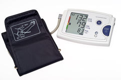Blood pressure monitor cutout. Automatic digital blood pressure monitor. Isolated on white with clipping path Royalty Free Stock Photos
