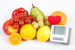 Blood pressure monitor and fruits with vegetables on white background, healthy lifestyle royalty free stock image