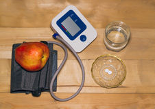 Blood pressure monitor and pills Stock Photography
