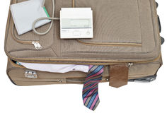 Blood pressure monitor on suitcase with male ties. Isolated on white background Stock Images