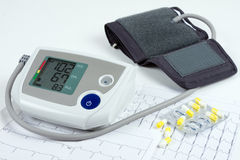 Blood pressure monitor, tablets and ECG Stock Photography