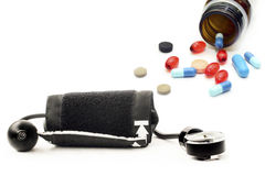 Blood pressure monitor and various pharmaceutical preparations Stock Photo